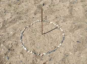 Sun clock in sand. The battle of Troy, the Troyan war, Iliad, Homer